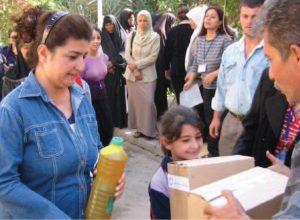 2003 | Syria - IOCC volunteers distributing hygiene and school kits to children