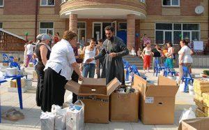 2008 | Georgia - IOCC volunteers distributing emergency supplies to displaced people