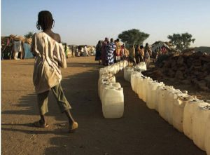2014 | Jordan, Ethiopia - People with cans of water