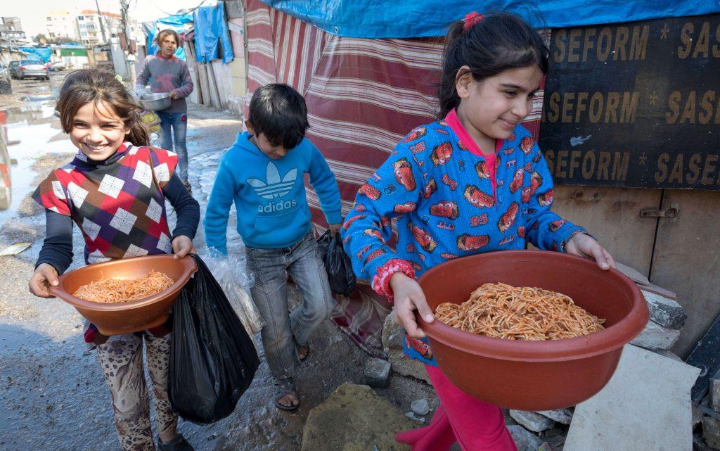 Kids receiving hot meals