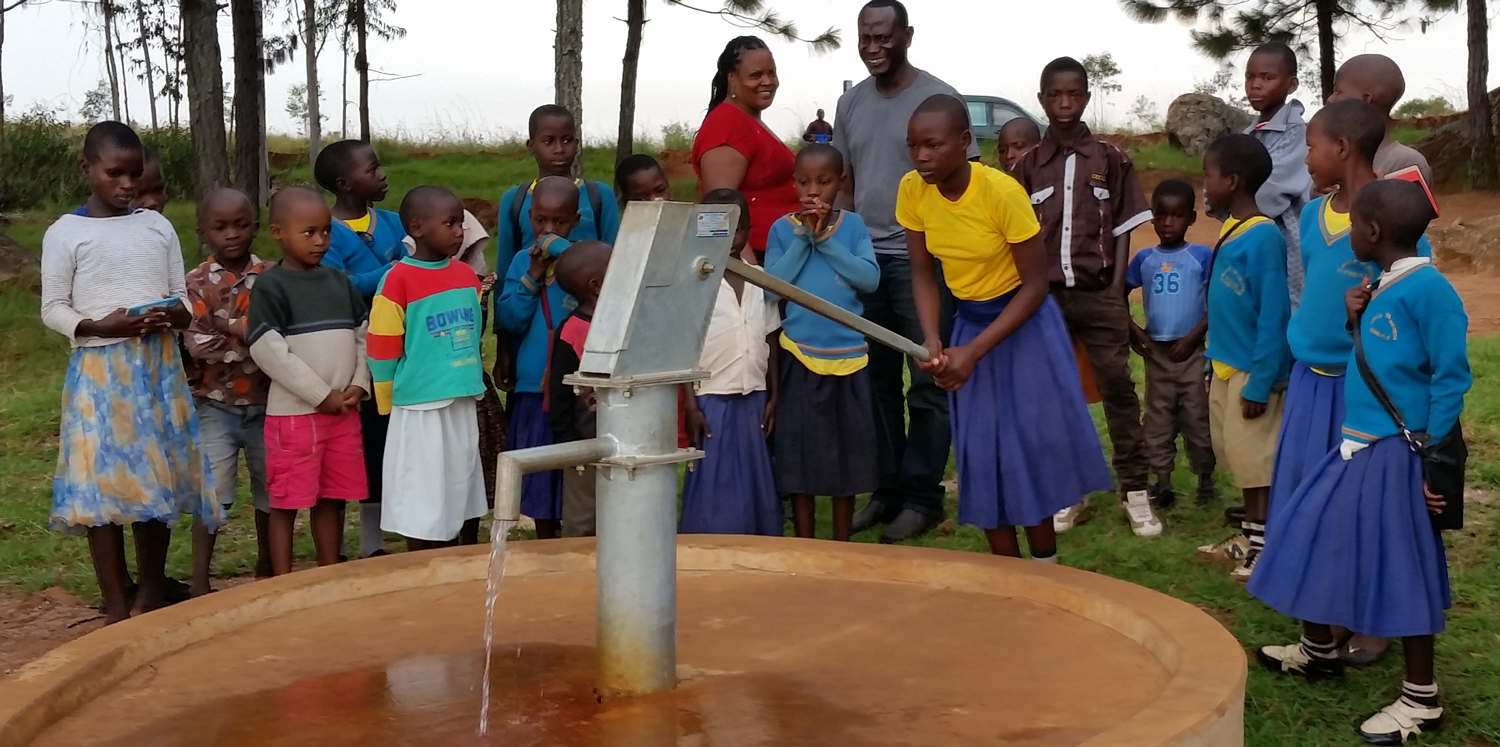 Child pumping water
